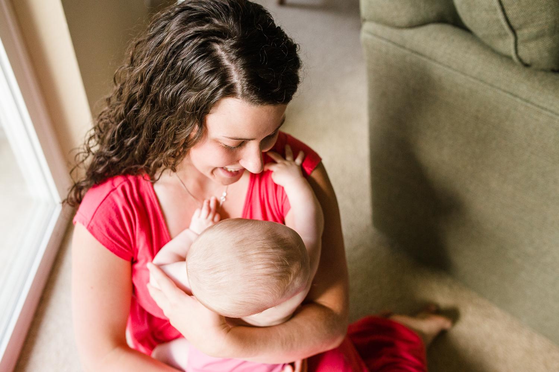 mom embracing infant daughter