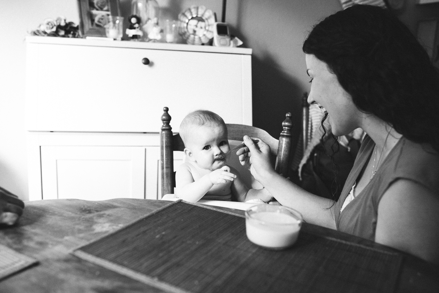 infant eating baby food