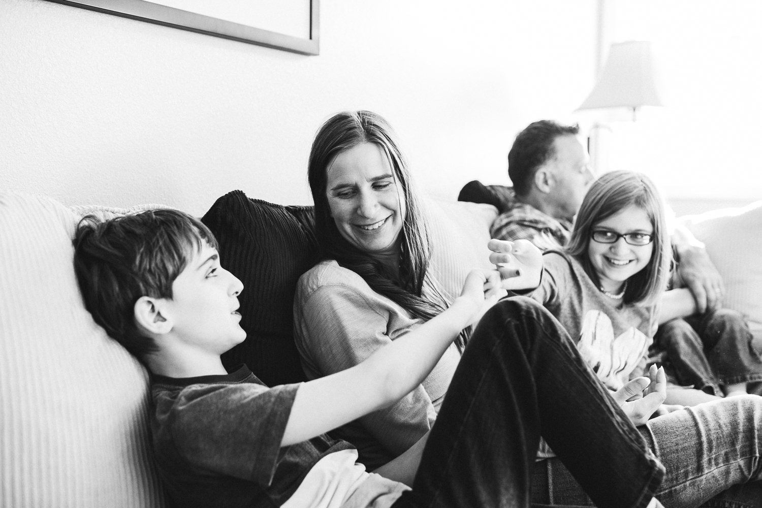 family hanging out on the couch