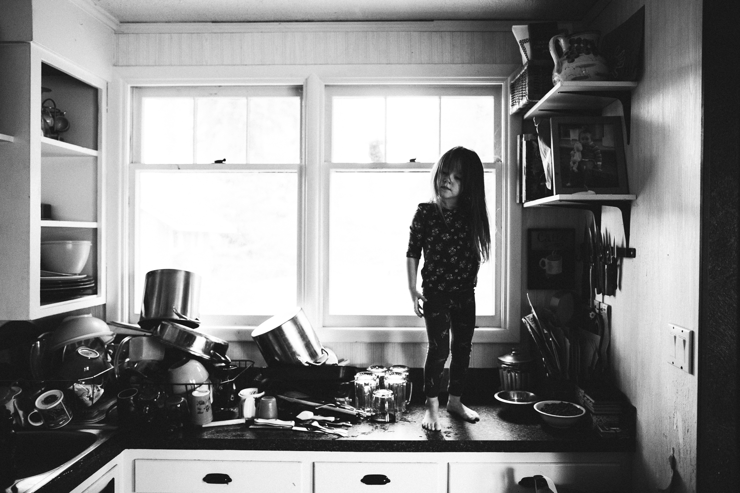 girl with long brown hair on counter