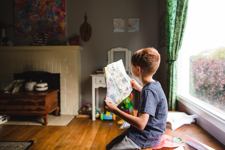 boy reading a magazine