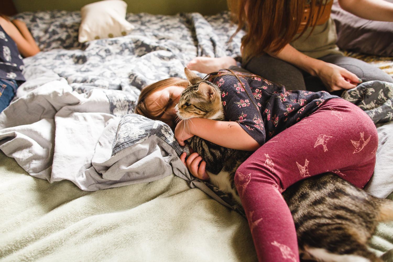 little girl holding cat