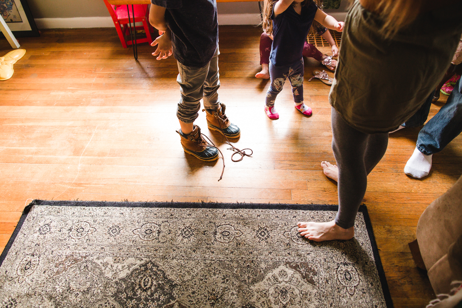 family getting on shoes