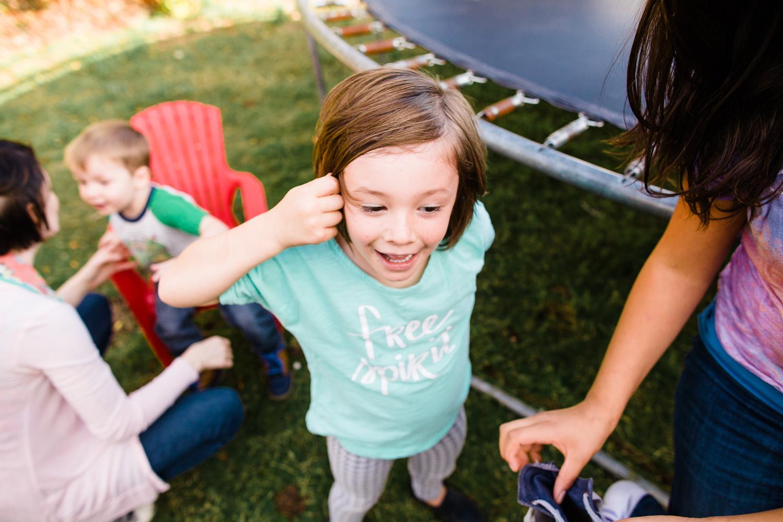 boy getting off a trampoline