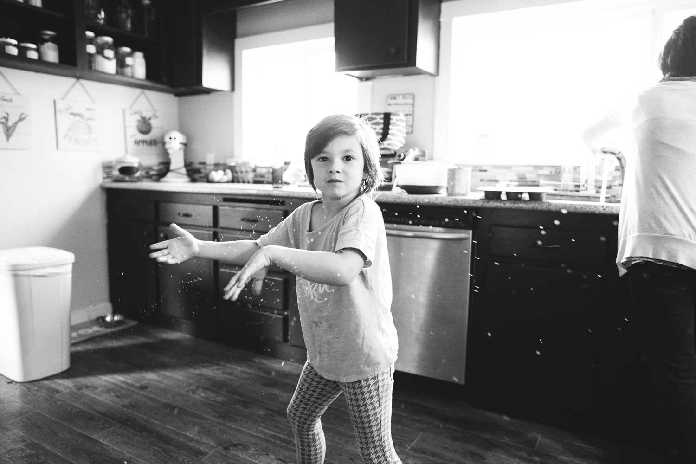 boy splashing water in the kitchen