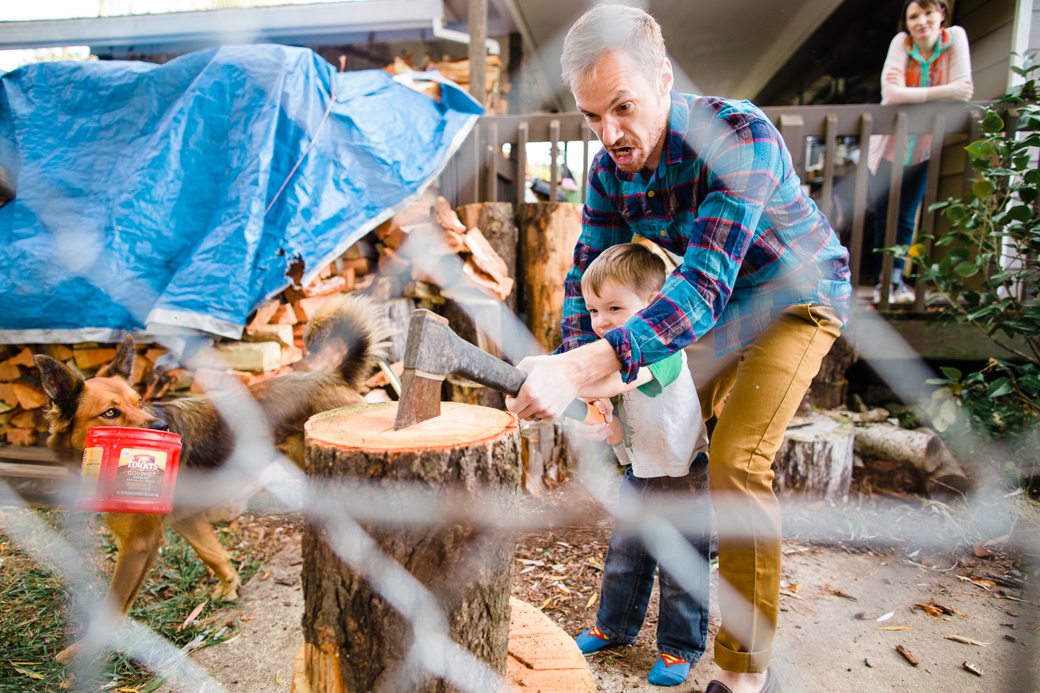 family cutting wood together