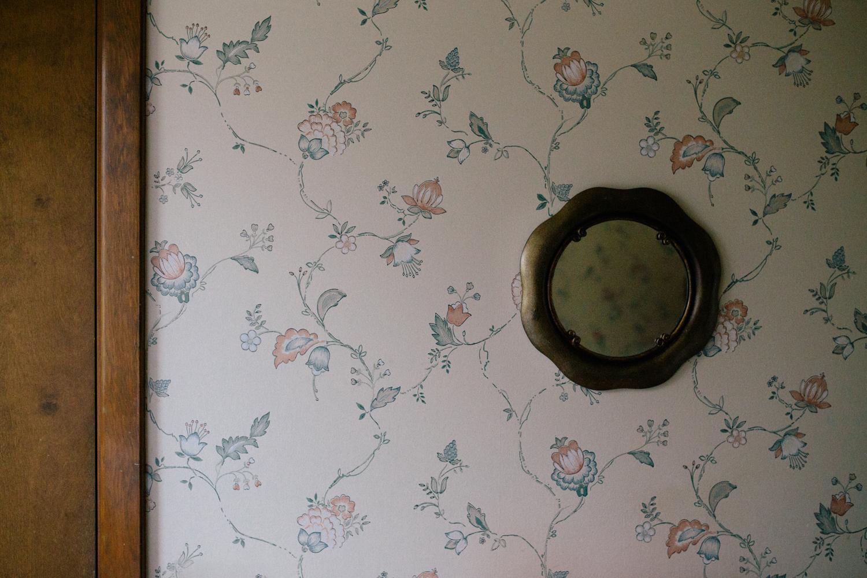 mirror hanging on bathroom wall