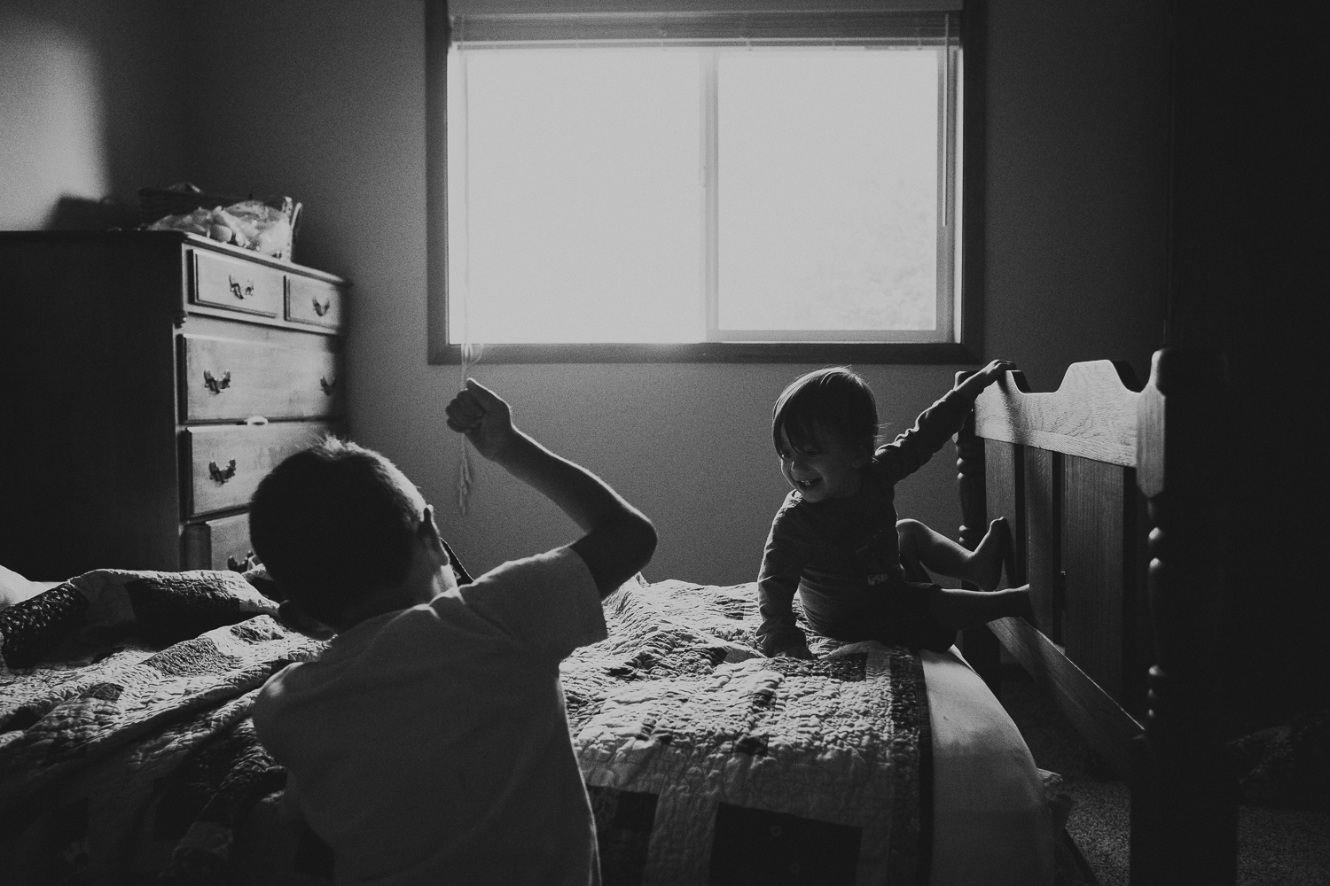 toddler boy playing with brother