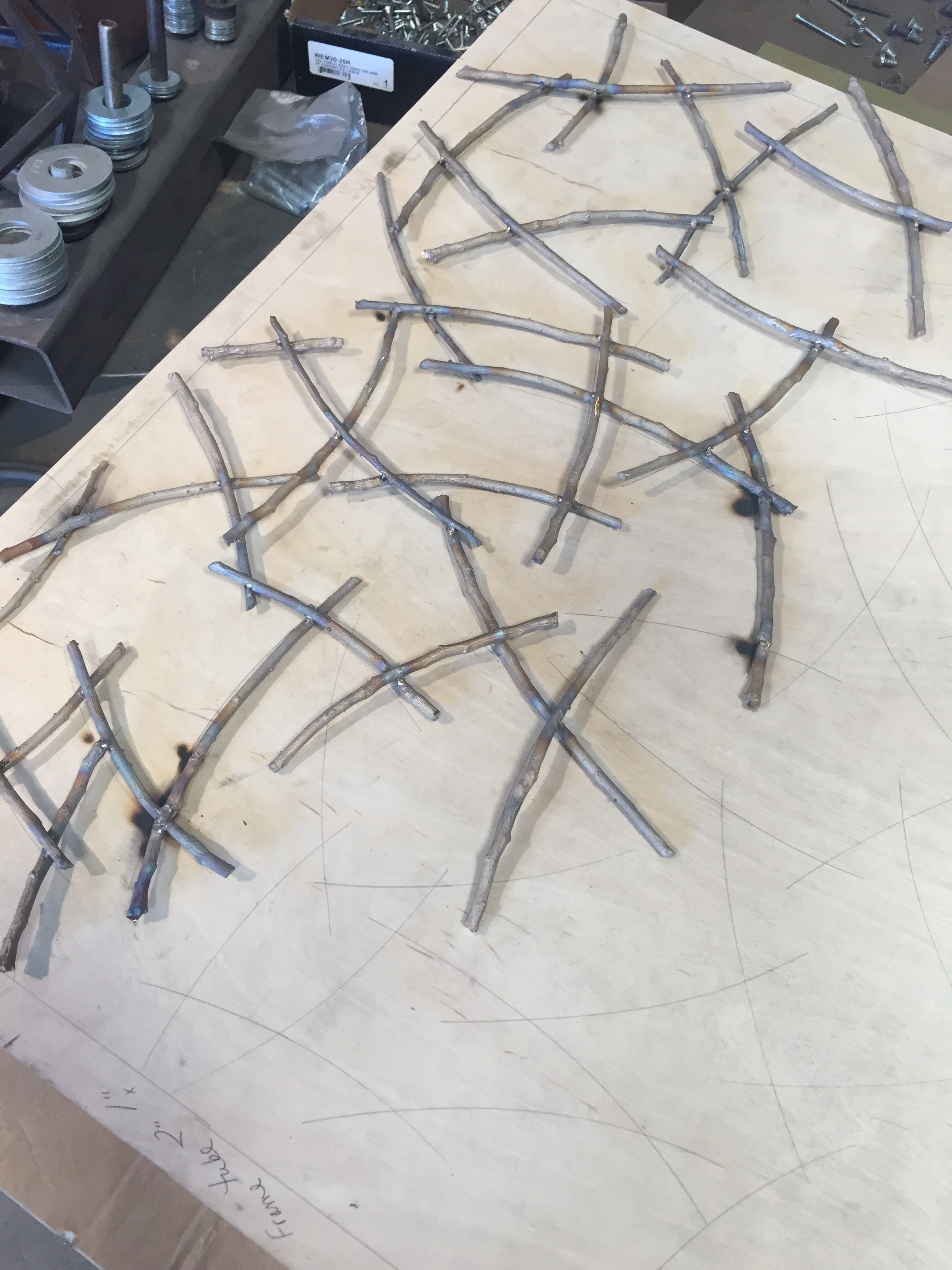 Beautiful brass twig lattice for garden gates being made by One-Off Furniture.