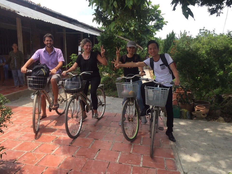 Lala and Ricardo. Lala Rebelo Travel Blog. About to have some two wheeled fun in the Mekong Delta.