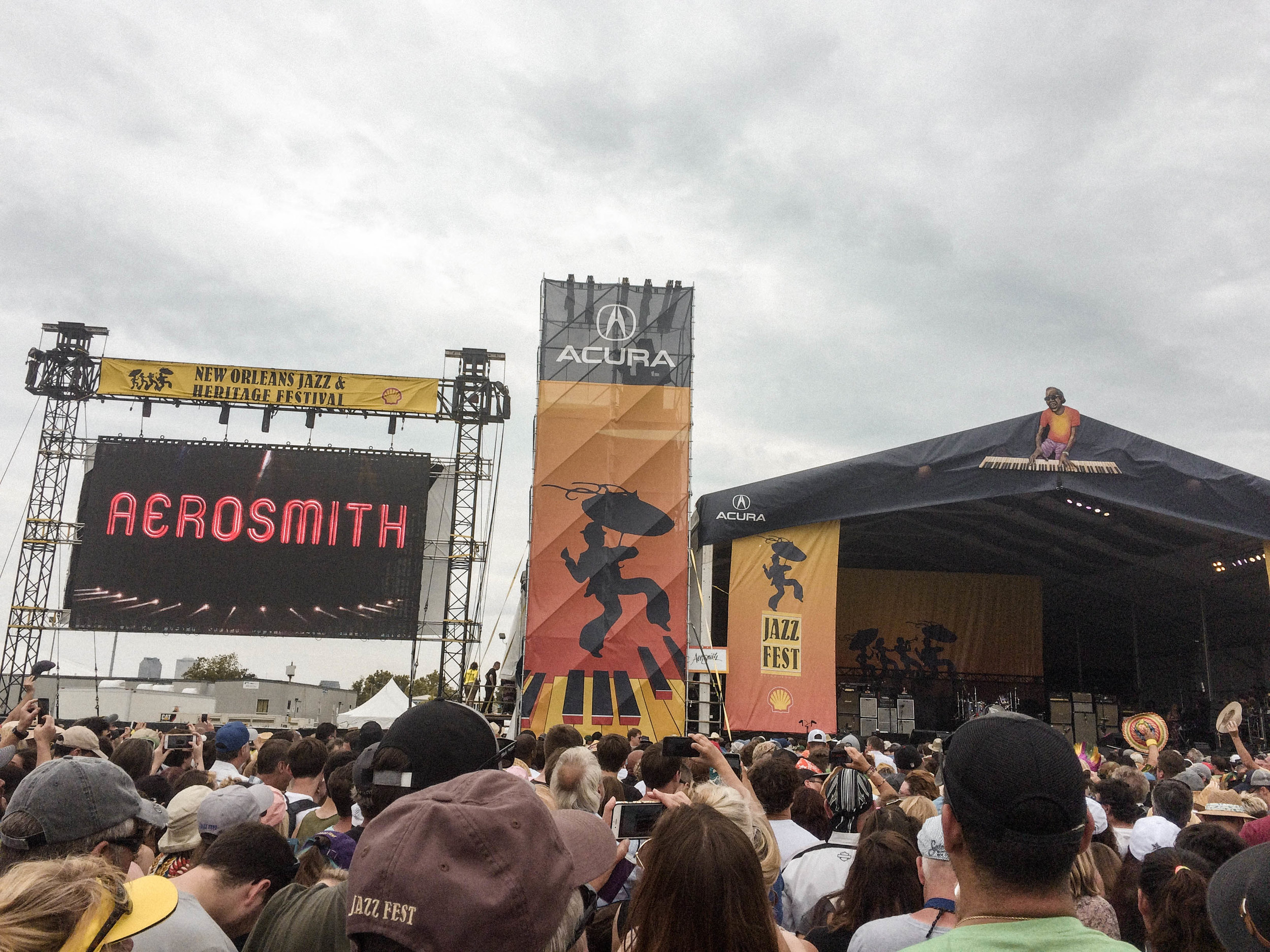 If you've ever held the belief that travel is expensive or solo travel is dangerous and scary - but have secretly wanted to do both - this post is for you!  My solo trip to New Orleans was the Abundant Result of flipping the script on those limiting beliefs! [Aerosmith at Jazz Fest in New Orleans]