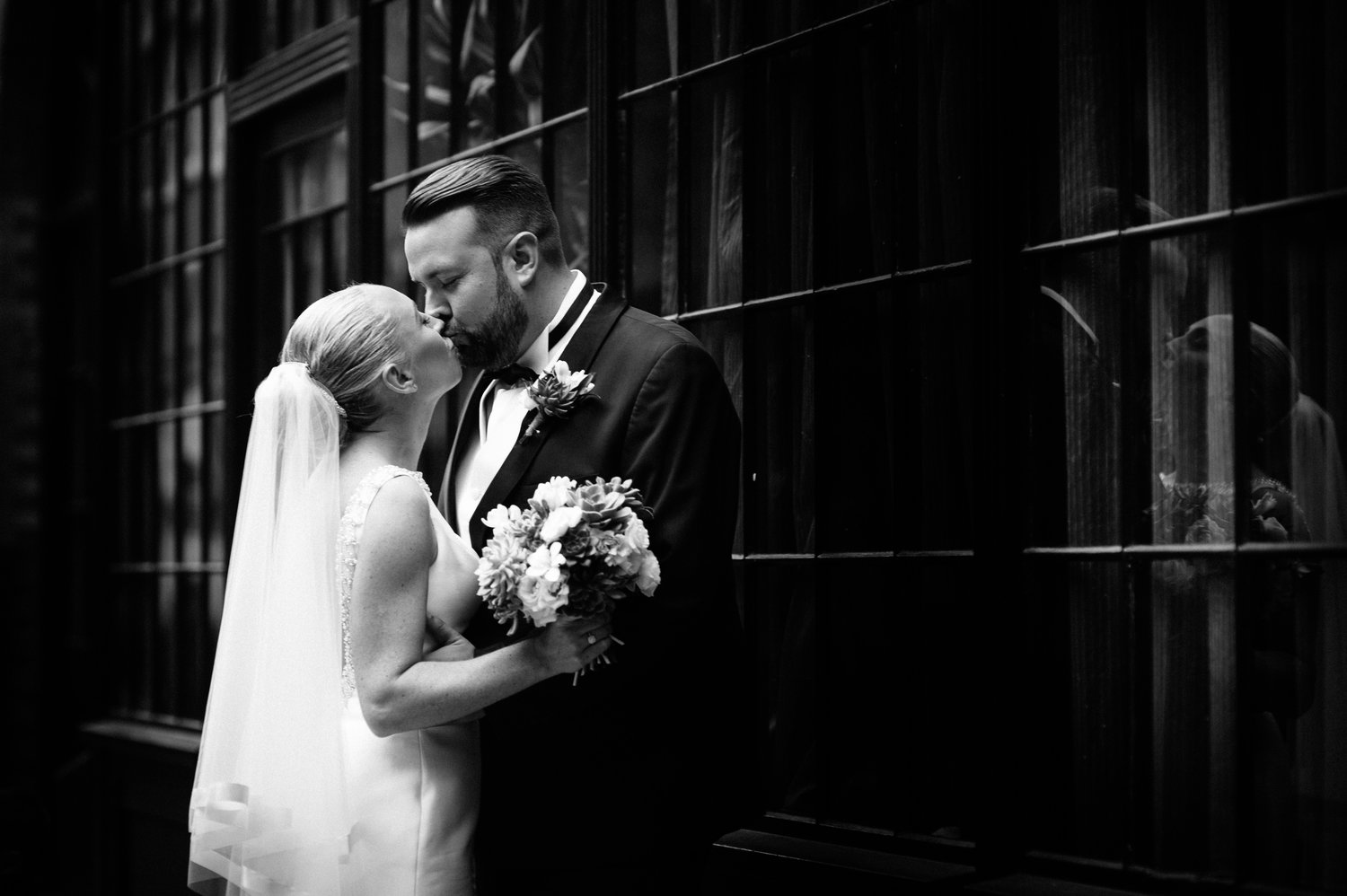 bride and groom kissing outside of Chiswell Street Dining Rooms