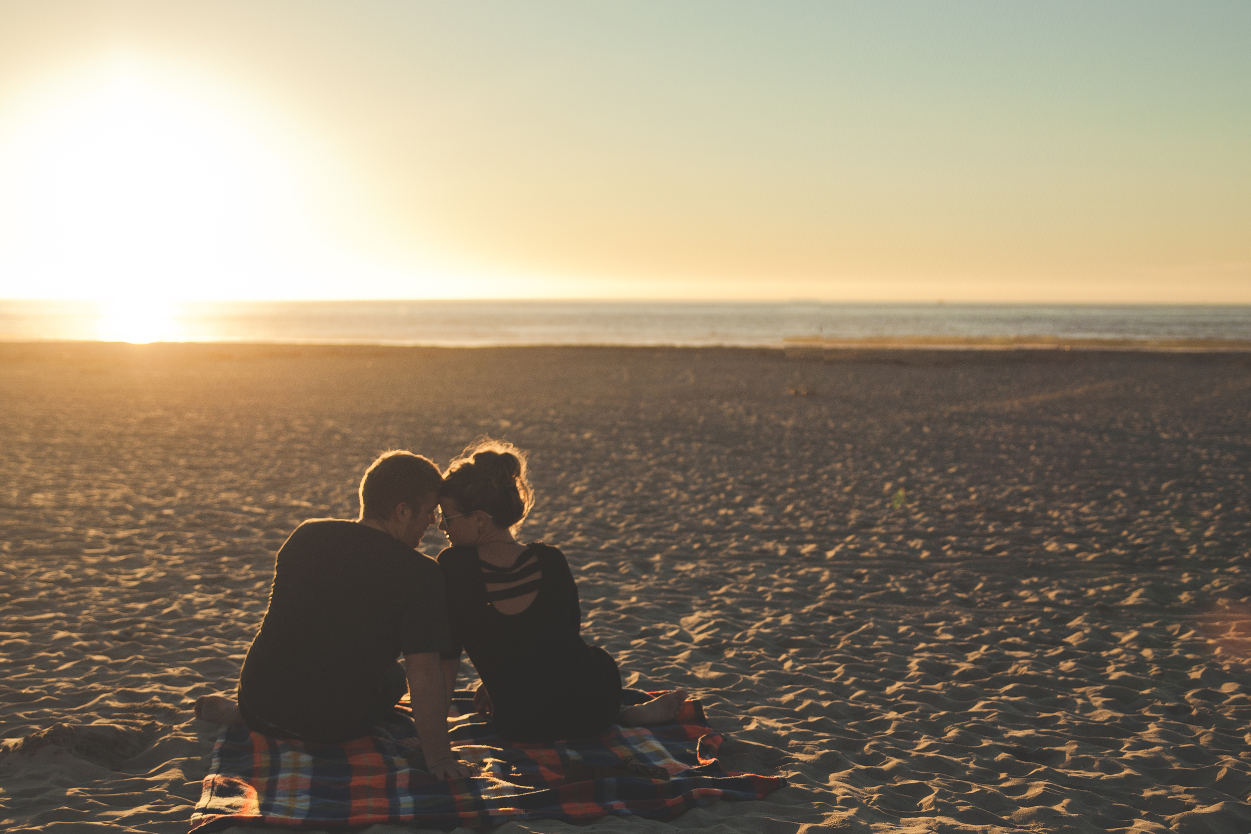 young couple beach communication