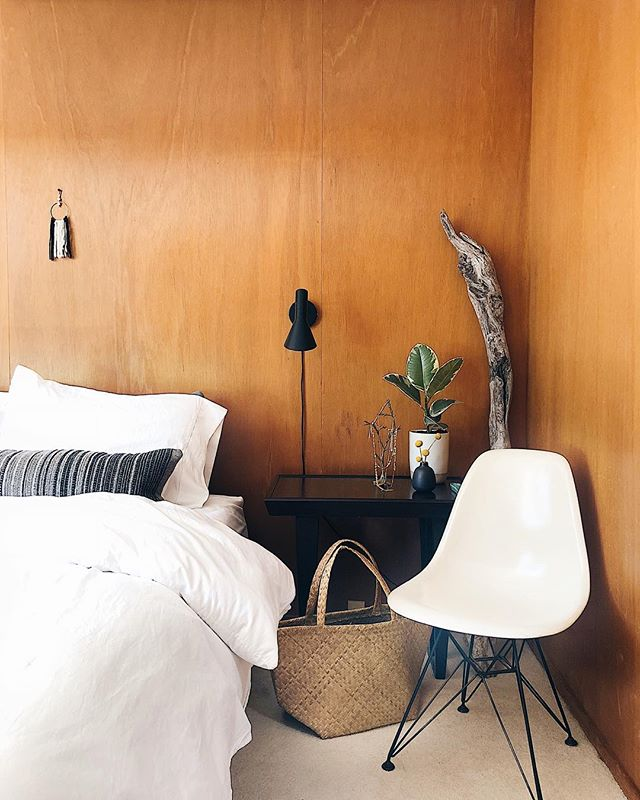 ✨ Bedroom corner, 2.0 ✨. . We installed our new lights and we now have non-wobbly lights that work! Eichlers are notoriously difficult to light. There are no basements or attic space to run wires. Wood paneling shows all marks, too, so we have to be careful where we place nails. . For now, the straw beach tote is holding books. My jewelry holder is doubling as decoration. Anyone else completely rearrange their room when you get a new piece? . In the back we have a giant driftwood branch Tim found on an anniversary trip up the Northern California coast. Any ideas what we can do with this? Maybe hang a weaving from it, suspend from the ceiling, just prop up in the corner? . . . . . #eichler #eichlerliving #eichlerhome #bedroom #woodpaneling #midcenturymodern #vintage #eameschair