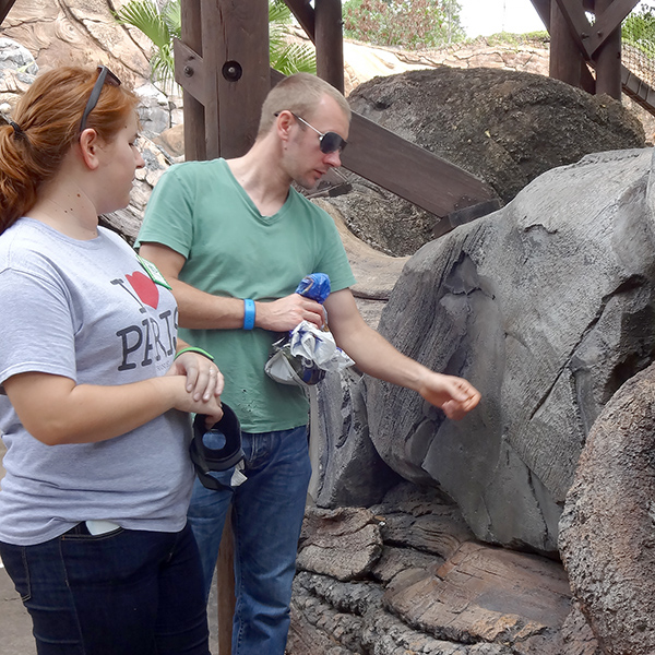 hailey and peter looking at rock.jpg