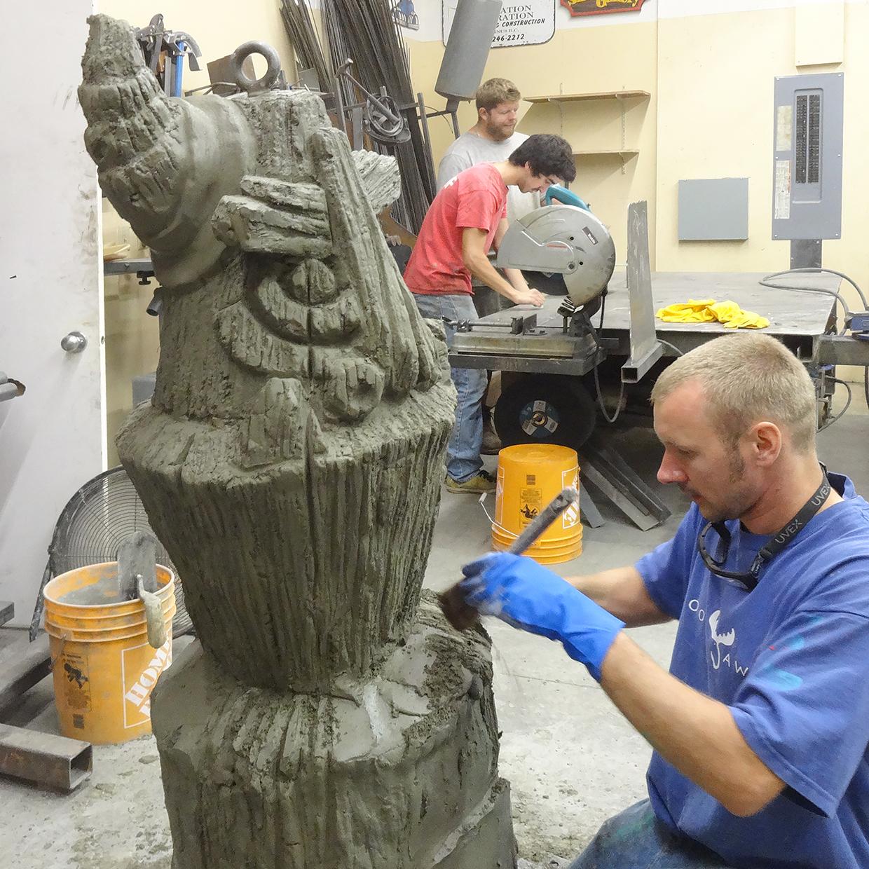 Peter Sawatzky happily carving a tiki.