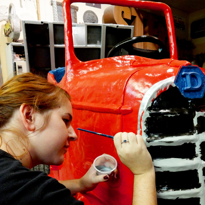 Hailey Sawatzky skillfully wielding a paintbrush.
