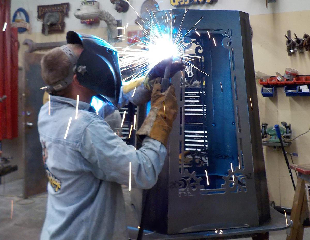 Peter welding a pedestal