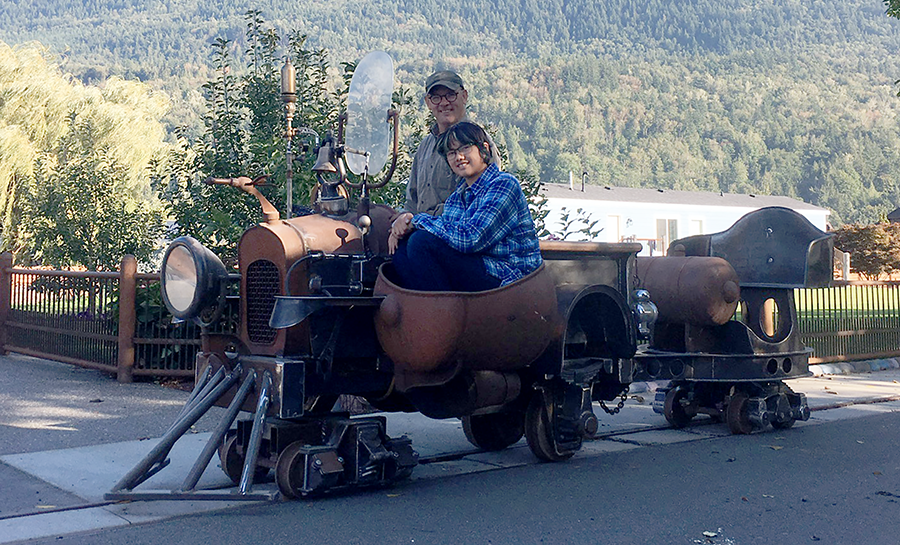 phoebe and grampa in rail truck.png