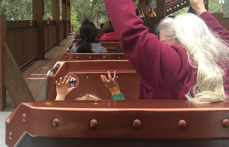 grandma and juniper in roller coaster.png