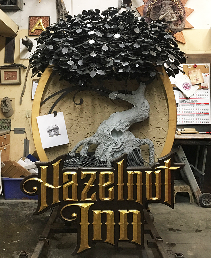 hazelnut inn sign leaves.png