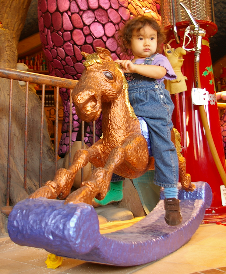 phoebe on rocking horse.png