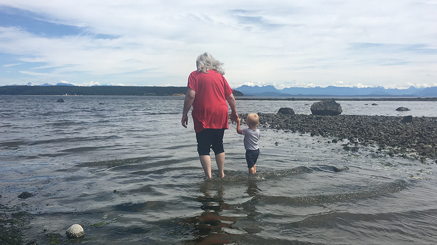 henry and grandma wading.png