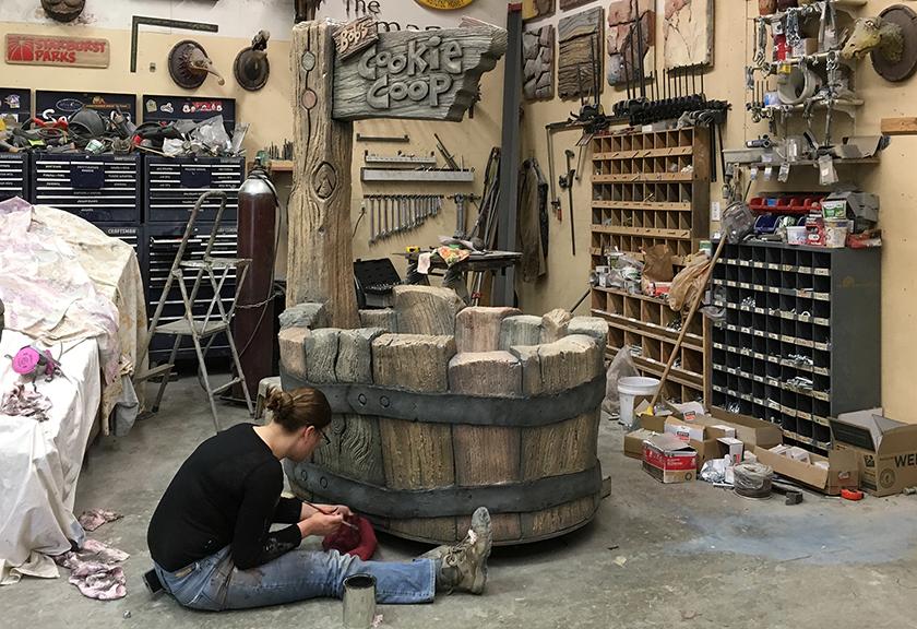alyssa painting barrels.png