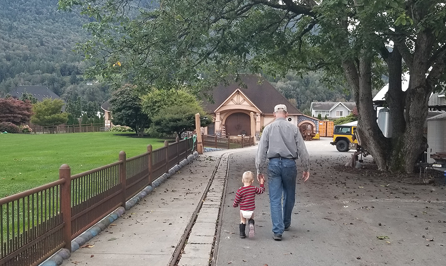 henry and grampa walkinng to shop.png