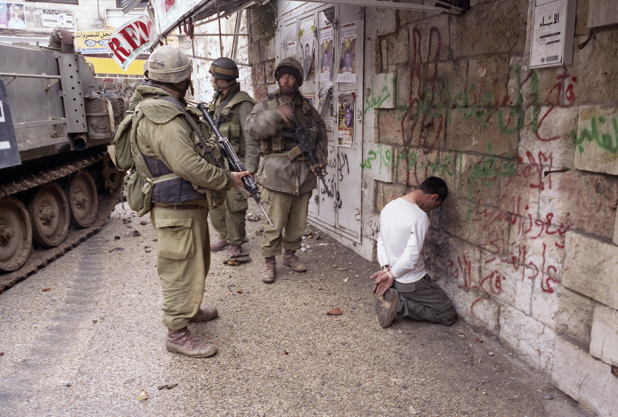 """Operation """"Defensive Shield"""", Palestinian civilans and armed forces surrender after IDF forces incursion, Ramallah, 2002."""