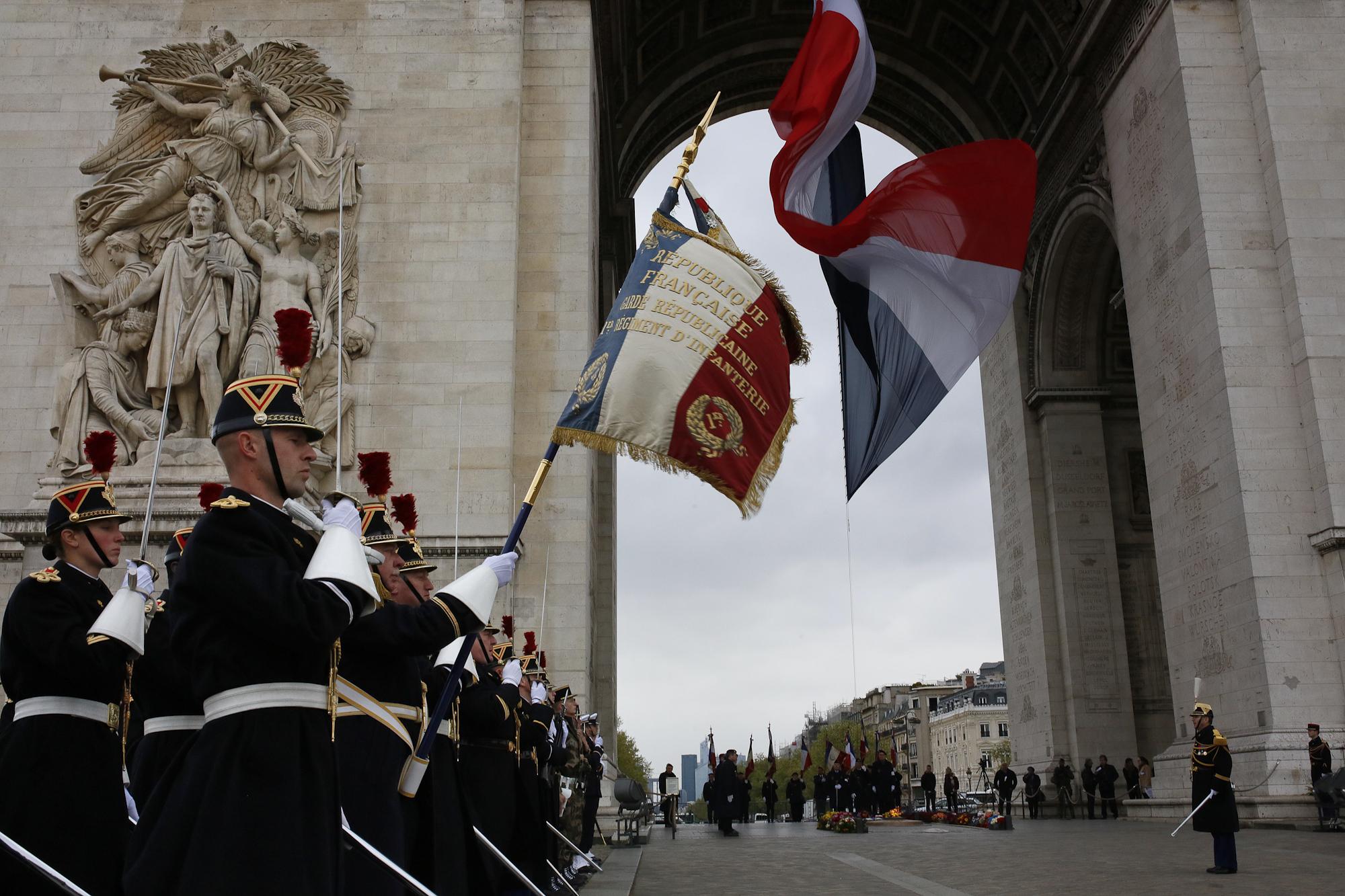 Ravivage (Rekindling Of The Unknown Soldier's Flame) ceremony, Arc de Triomphe Monument, Paris.