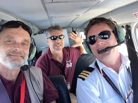 Alastair, team member Darren and pilot Cameron taking aid to Anatom