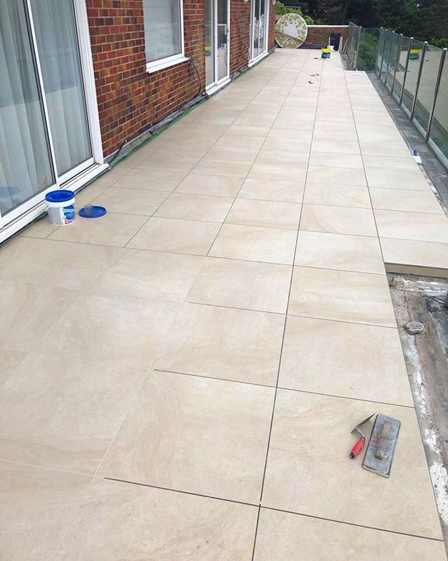 Grouting progress...A little while to go yet! 😅 . . . . . . . . . . #balcony #tile #grout #tiling #design #living #house #home #luxuryhomes #luxuryhome #sea #sun #grouting #porcelain #balconyview #outside #sunshine #renovation #interiordesign #interior #architecture #architect #dorset #progress #instagram #tilingwork #exteriordesign #exterior #mapei #exteriordecor