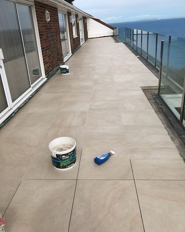 Grouting progress. Nearly there! . . . . . . . . . . #balcony #tile #grout #tiling #design #living #house #home #luxuryhomes #luxuryhome #sea #sun #grouting #porcelain #balconyview #outside #sunshine #renovation #interiordesign #interior #architecture #architect #dorset #progress #instagram #tilingwork #exteriordesign #exterior #mapei #exteriordecor