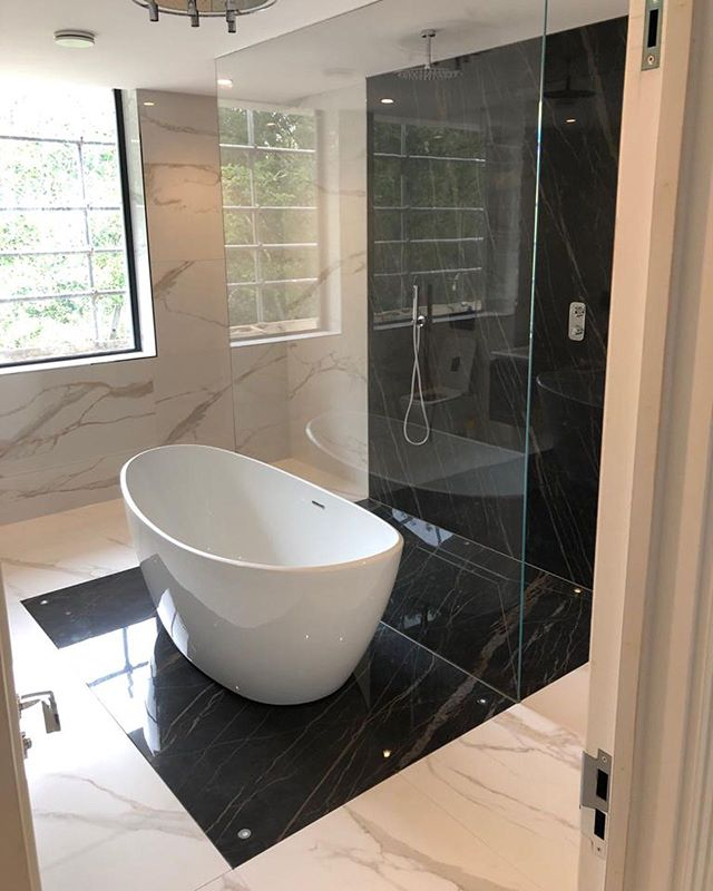 Finished job from the large format bathroom we have been working on👌🏽 . . . . . . . . . . . #tile #tileinstallation #design #living #bathroomdesign #bathroom #large #largeformattiles #construction #renovation #reno #bathroomdecor #bathroomtiles #home #house #luxuryhomes #luxuryhouses #interiordesign #interior #interiors #architecture #architect #tilingwork #tilefloor #tileshower #bathroomtiles #porcelain #shower #style #luxury #feature