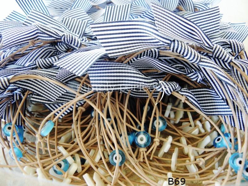 ~navy blue~ Δερμάτινο μαρτυρικό με γυάλινο ματάκι και φίλντσι σταυρό: ΚΩΔ Β69