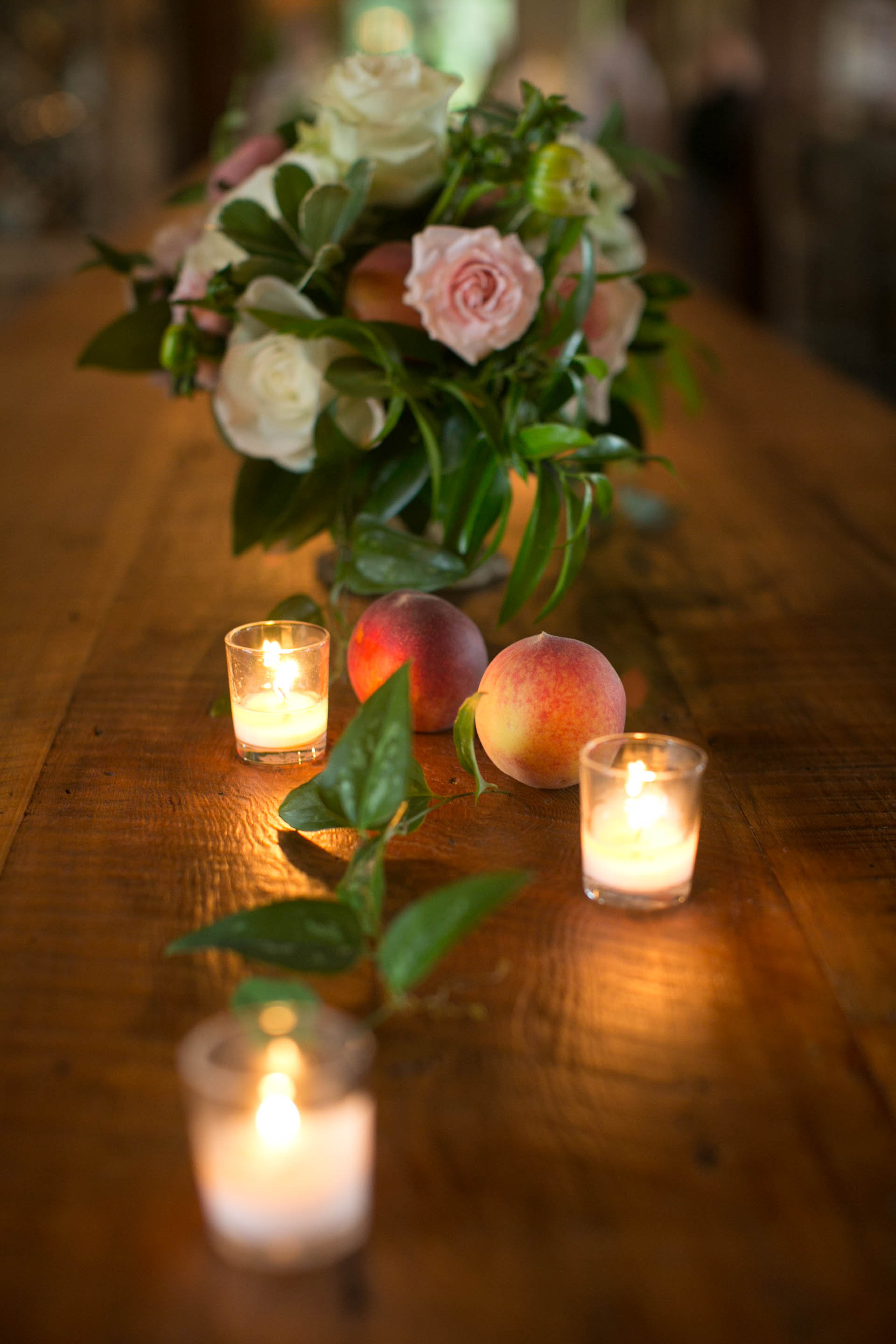 Reception centerpiece on farm table