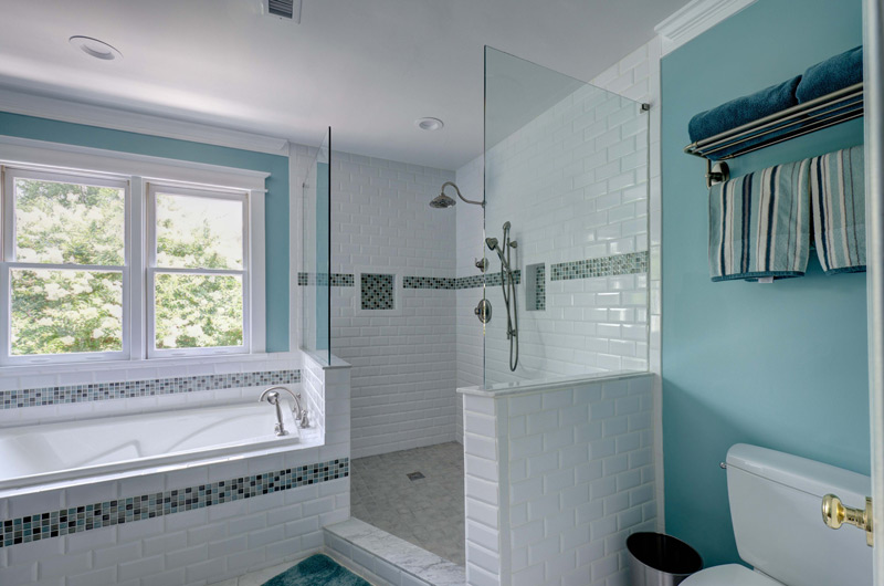 Blue Bathroom with White Subway Tiles