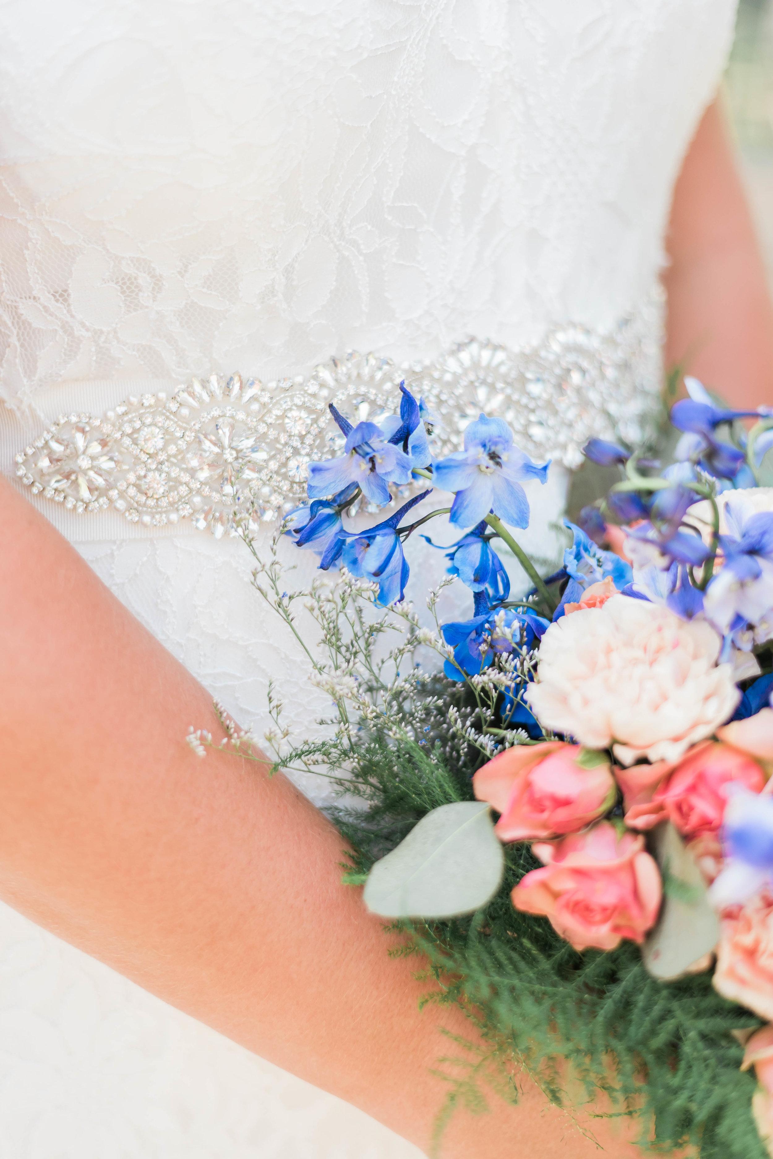 bride bouquet detail shot with dress