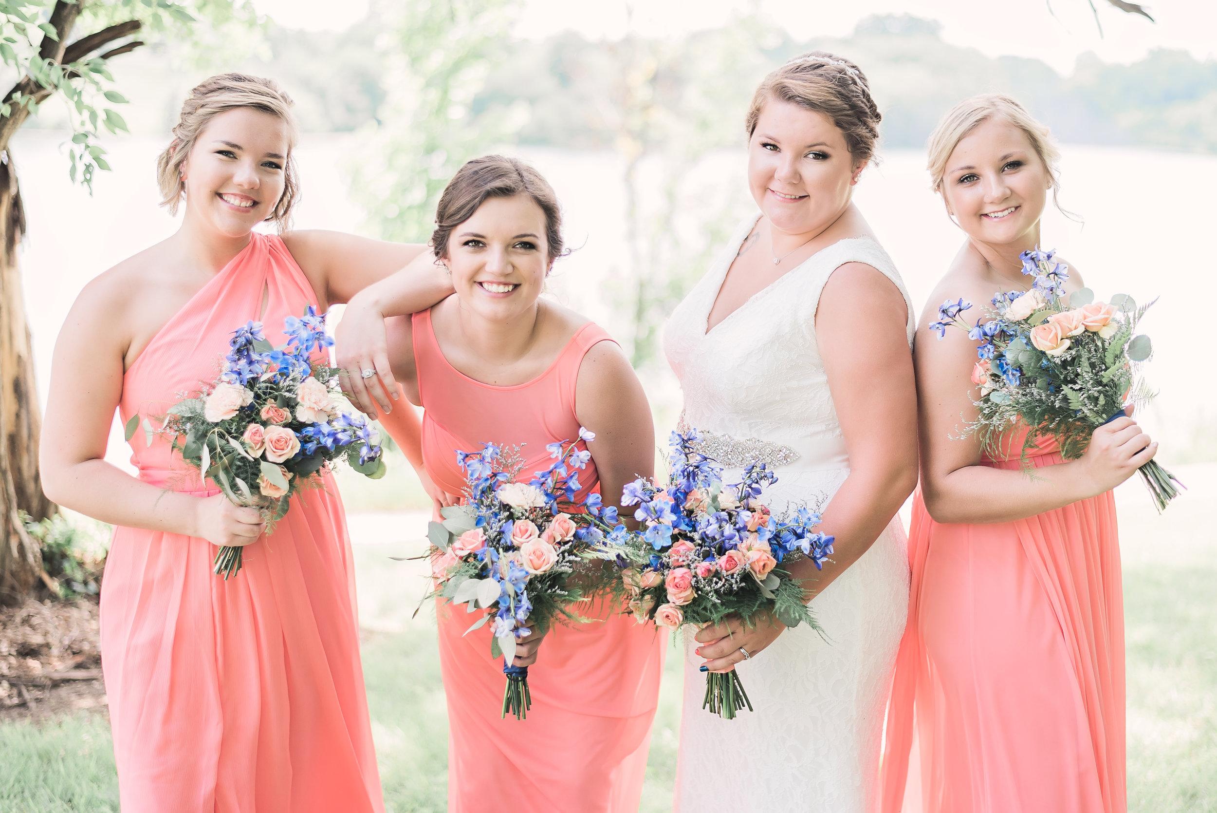 bridesmaids coral dress outside fun pose