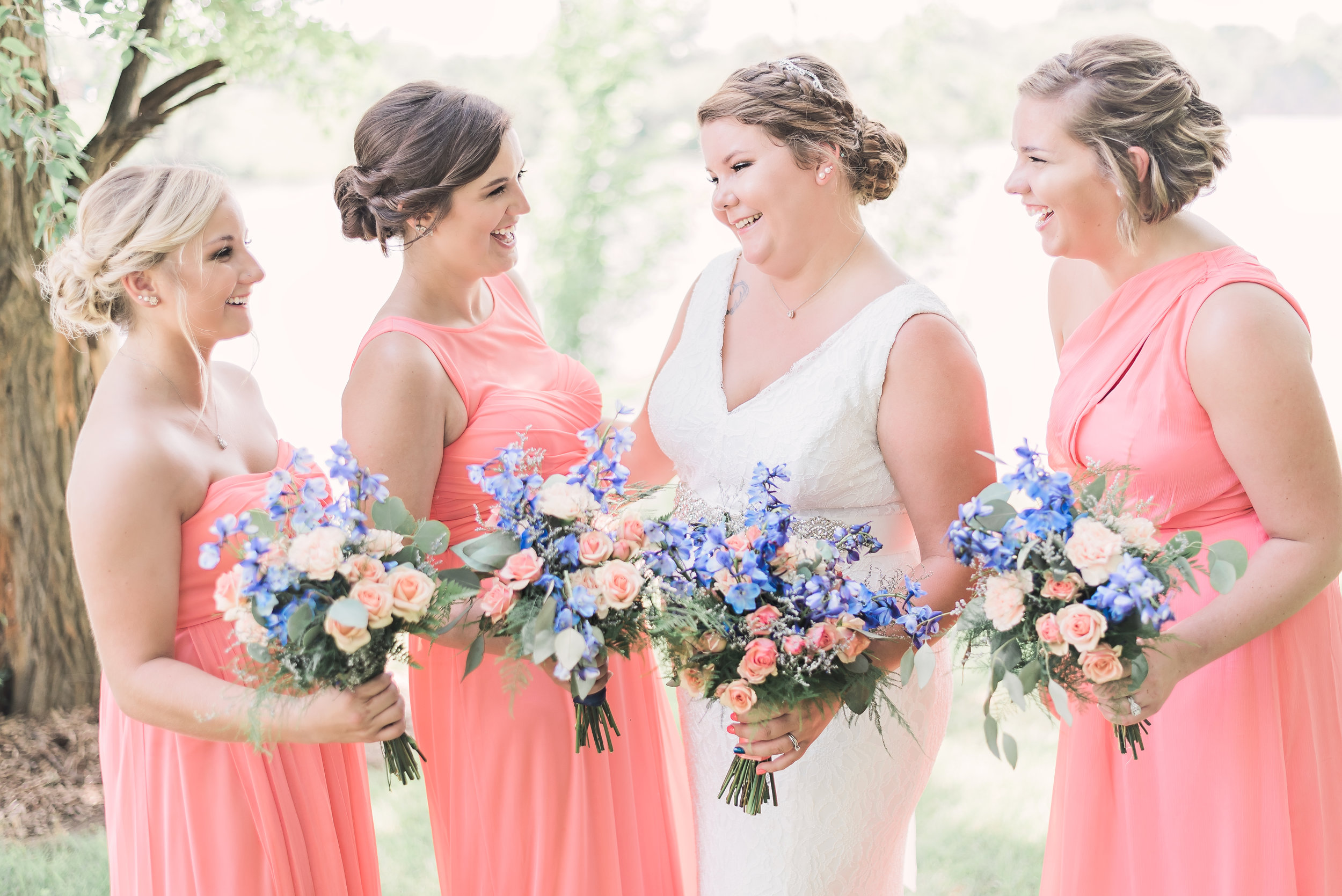 bridesmaids with bride laughing