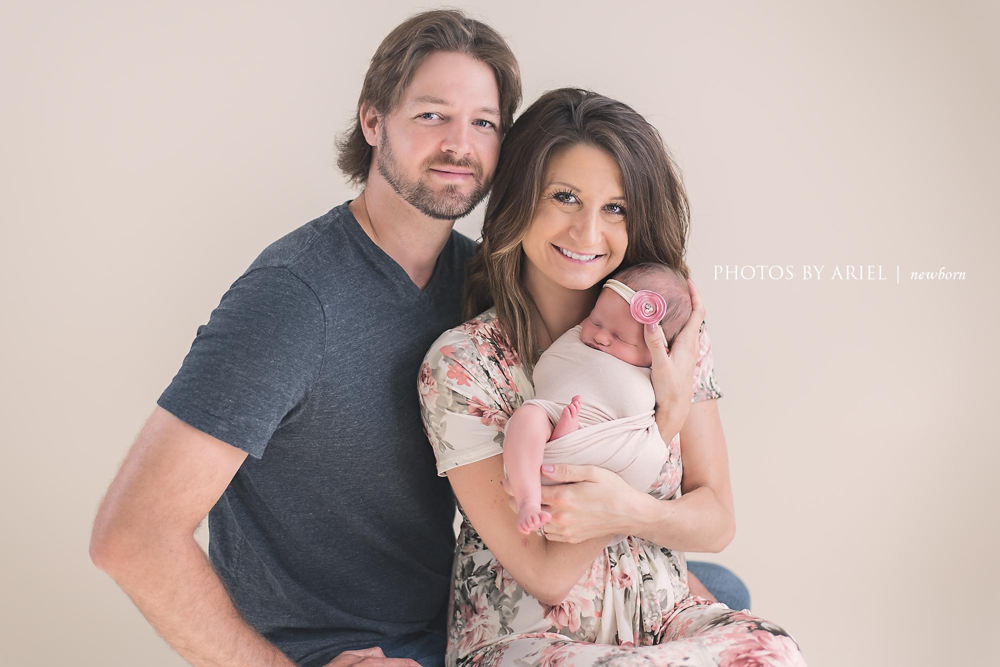 mom and dad newborn head tilt