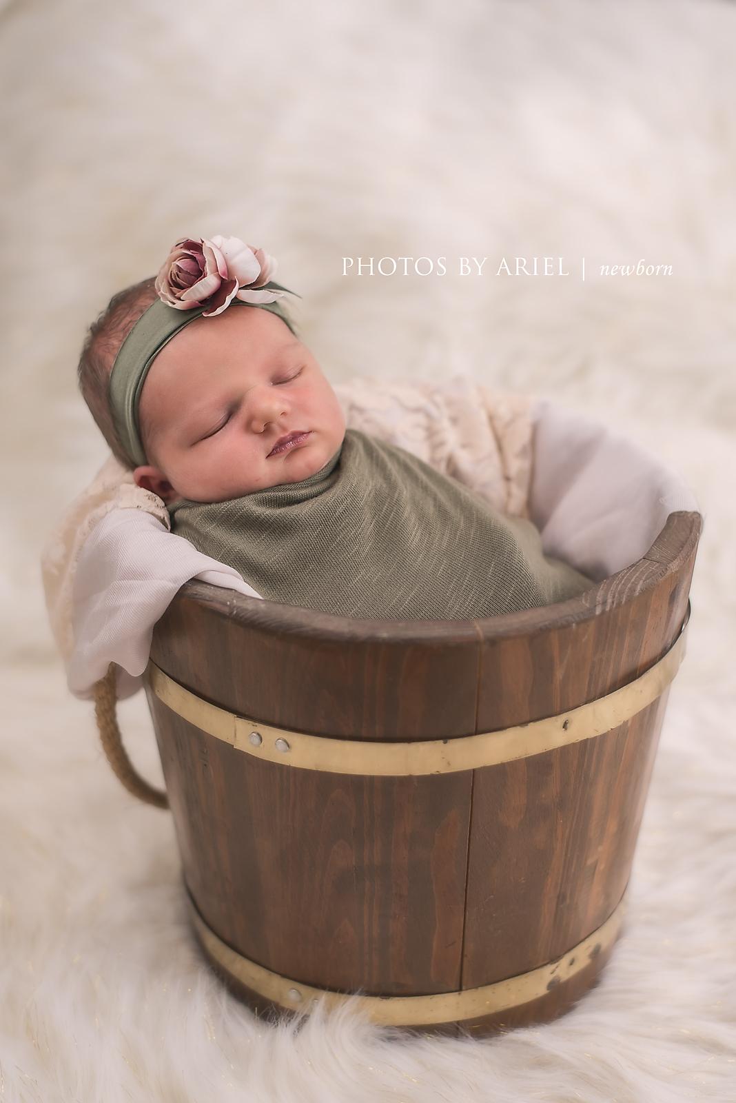 newborn in bucket