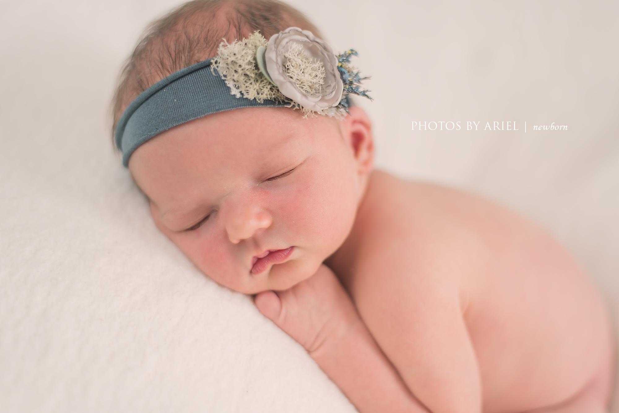 close up baby girl in blue headband
