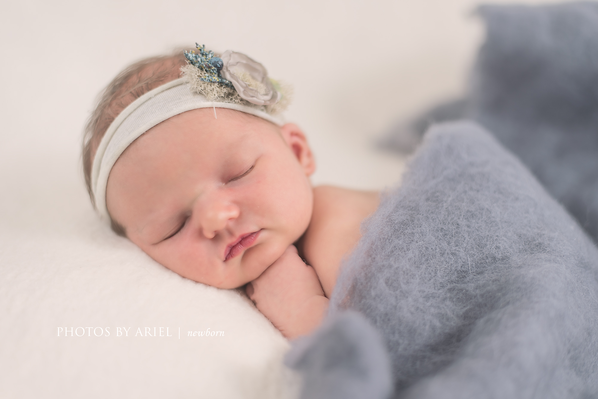 baby girl wrapped in wool