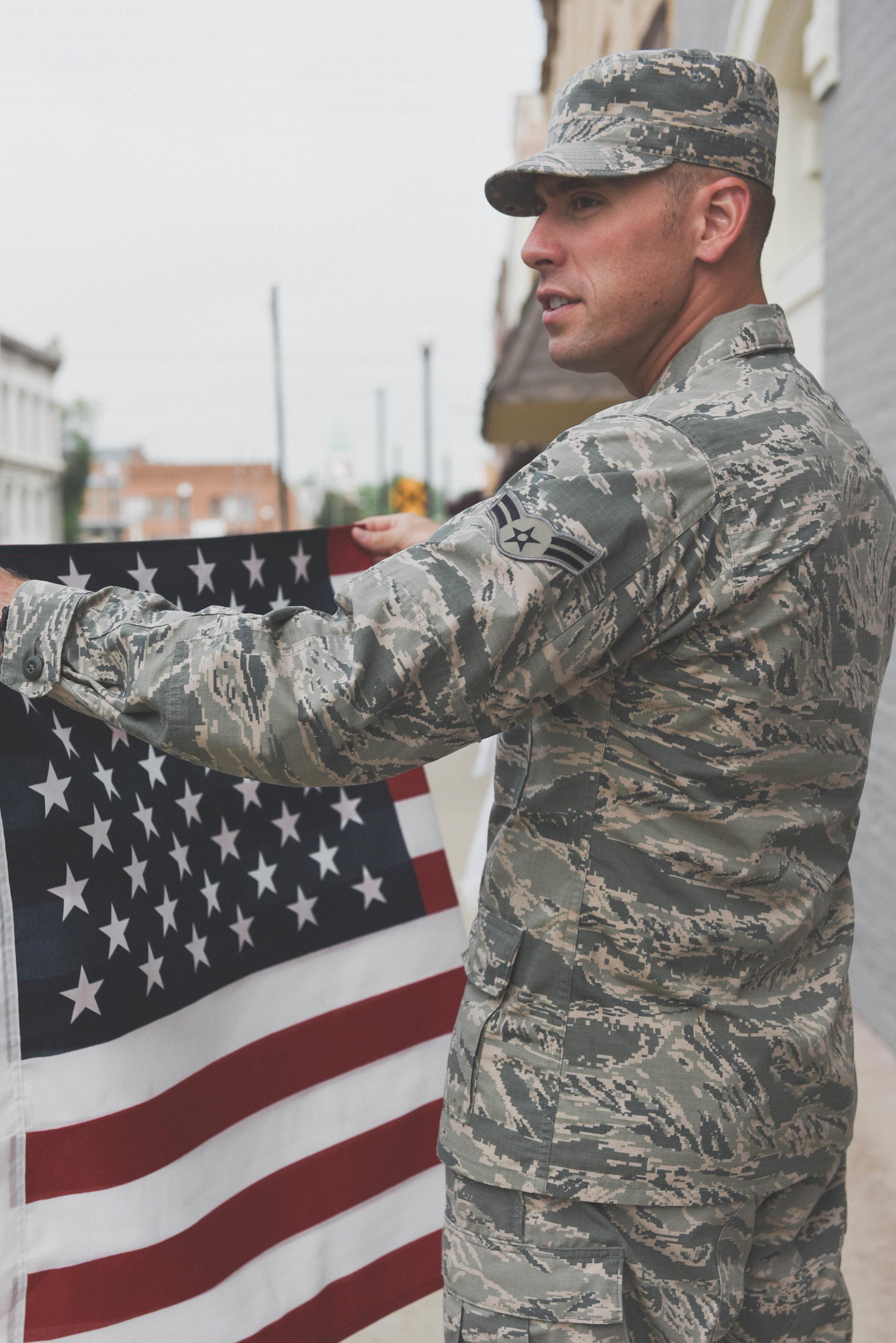 military man folding flag