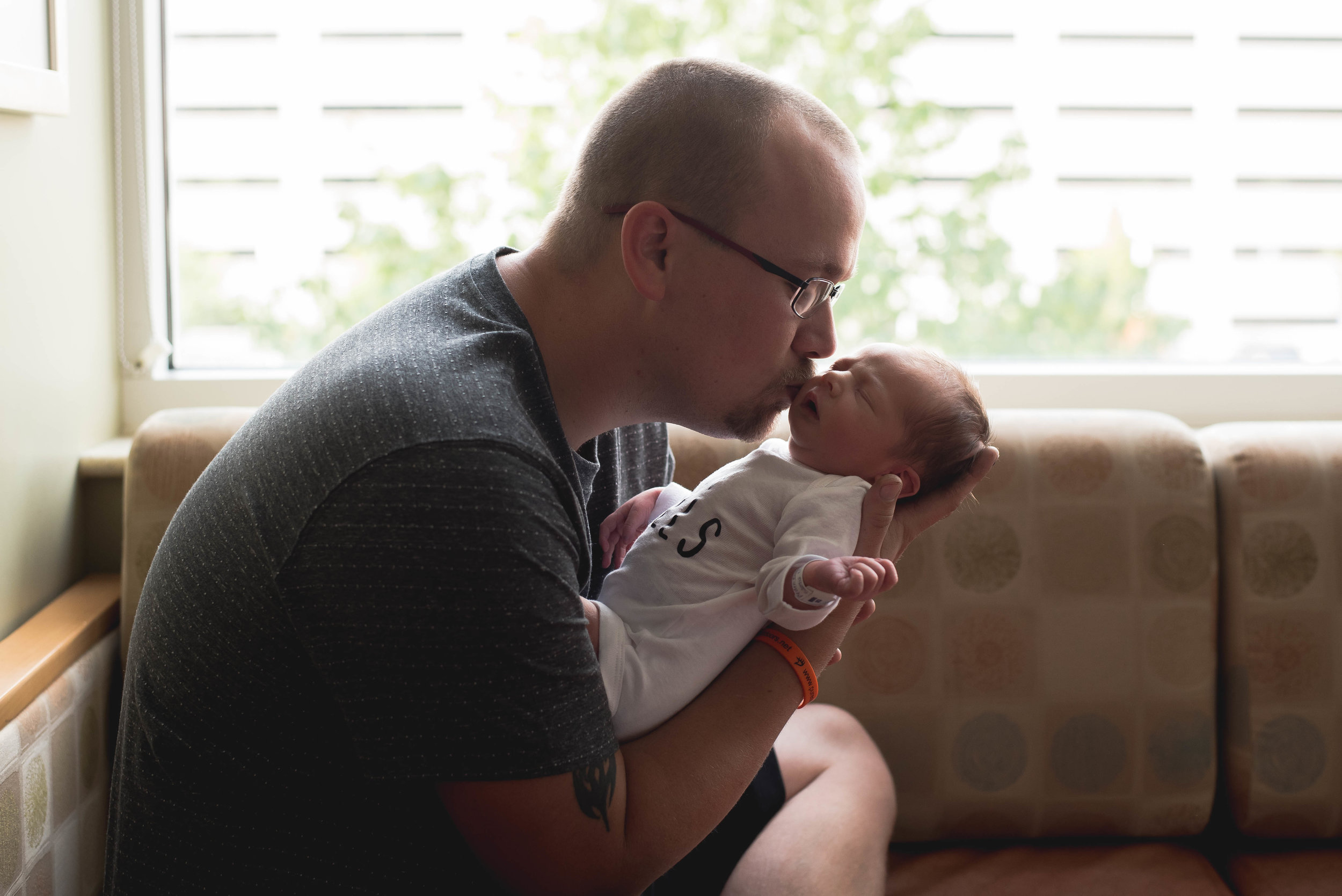 daddy kisses baby's nose