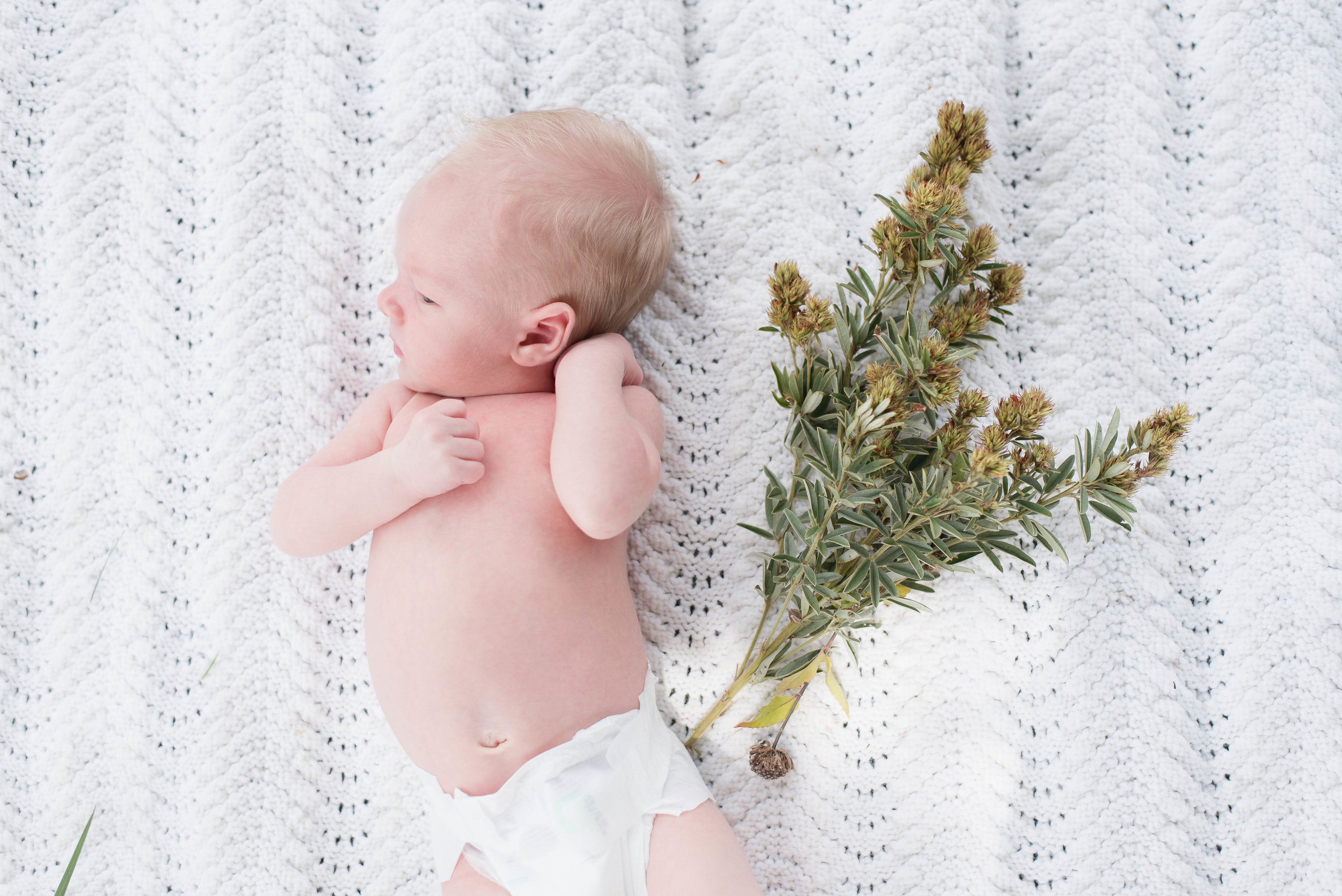 baby with flowers in diaper
