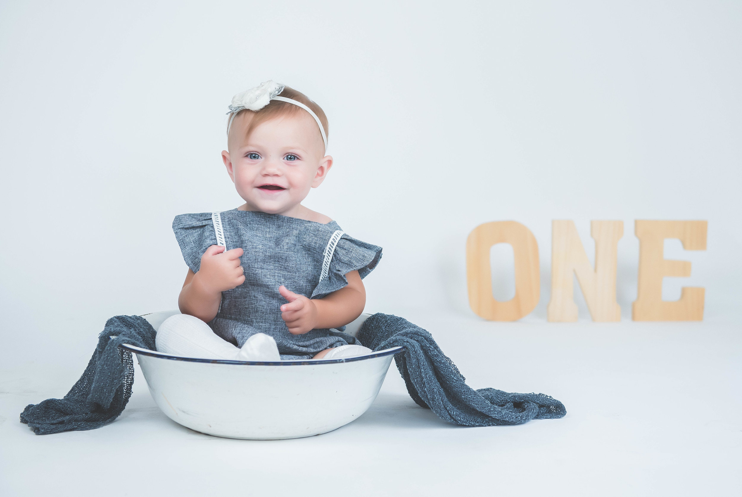 baby girl cute smile in bowl