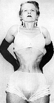 """""""Ethel Granger, who laced to just 13"""" in her corset over several decades, experienced weakness in her core, but as shown here, was still able stand without her corset."""" Yes, ladies and gentlemen, she was still able to STAND... obviously, because her core was so """"strengthened."""""""